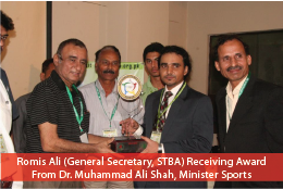 Romis Ali (General Secretary, STBA) Receiving Award Shield From Dr. Muhammad Ali Shah, Minister Sports