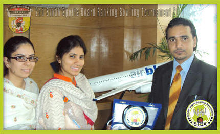 Mr. Romis Ali (General Secretary, STBA) honouring Ms. Sarah Khoso (Assitant Manager Marketing, AirBlue) with souvenir for the noteworthy support in 2nd Sindh Sport Board Ranking Bowling Tournament 2011